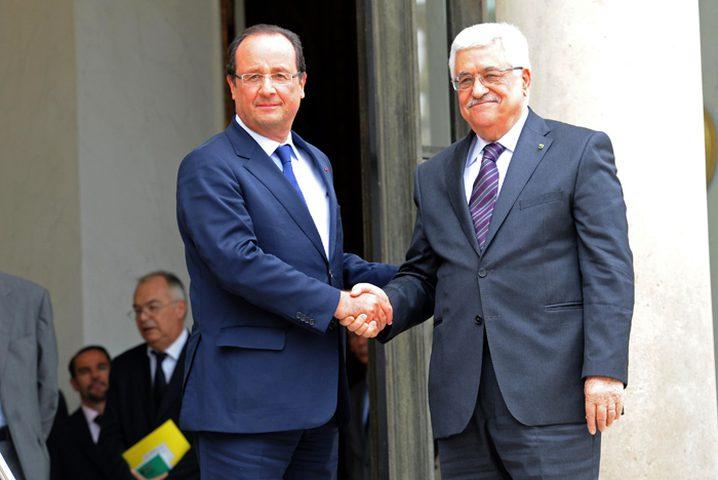 الرئيس يتوعد من باريس بتقديم ملف الاستيطان للمحاكم