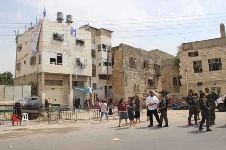 مسيرة في الخليل تطالب بإخلاء منزل عائلة أبو رجب