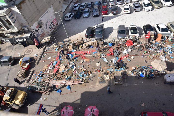 بالصور: بلدية نابلس تزيل البسطات من شارع العدل..والسبب؟