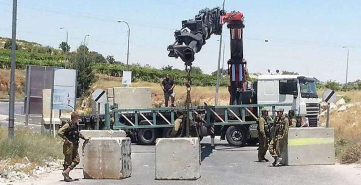 الاحتلال يغلق مدخل اللبن الشرقية ببوابة حديدية ومكعبات اسمنتية (صورة)
