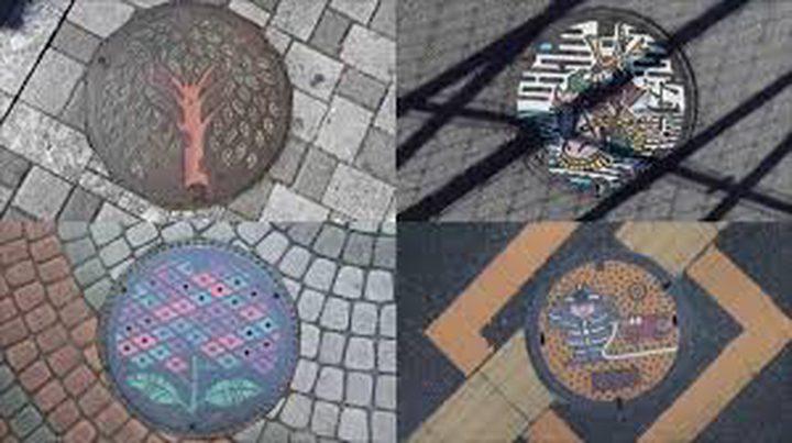 """يابانيون يحولون """"أغطية التصريف"""" لأعمال فنية"""