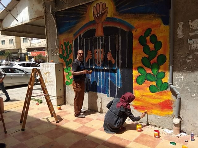 جدارية يوم الأسير الفلسطيني في جنين