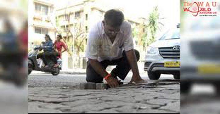 فاجعة دفعت رجلا إلى سد مئات الحفر في الطرقات