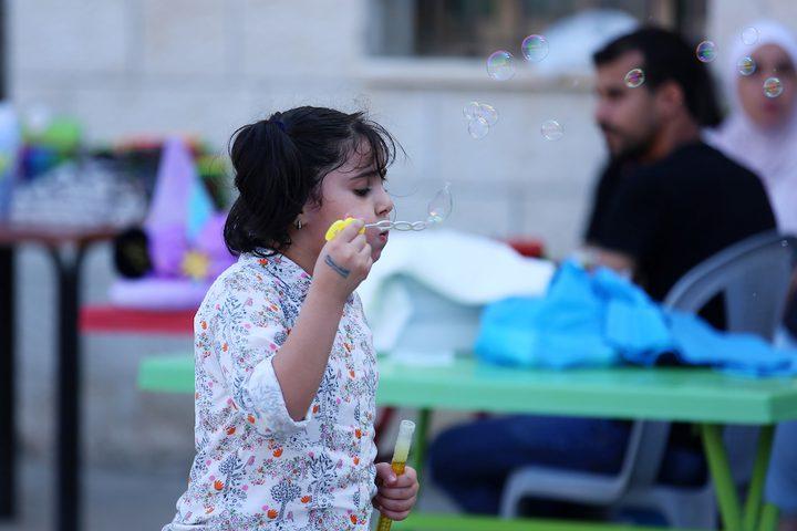 أطفاليستمتعون بوقتهم في اليوم الثالث من عيد الأضحى في النصيرات بوسط قطاع غزة في 23 أغسطس 2018.