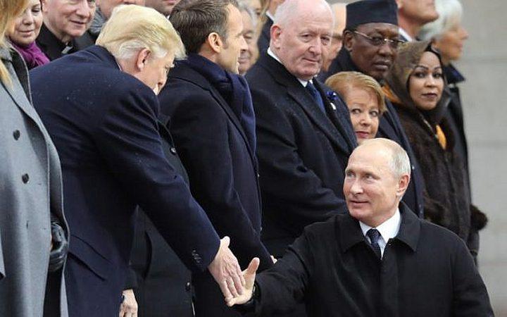 ترامب وبوتين يبحثان قضايا العالم في باريس