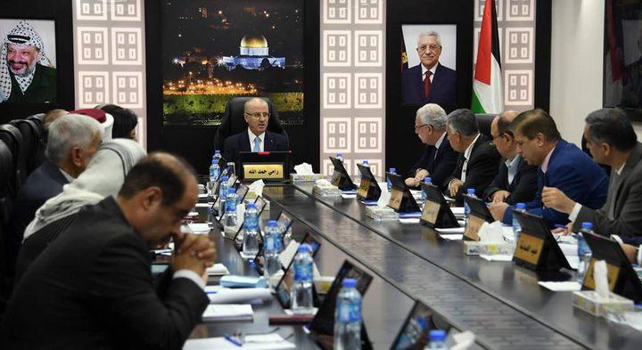 الحكومة تطالب حماس بالعمل فوراً لتمكينها في غزة