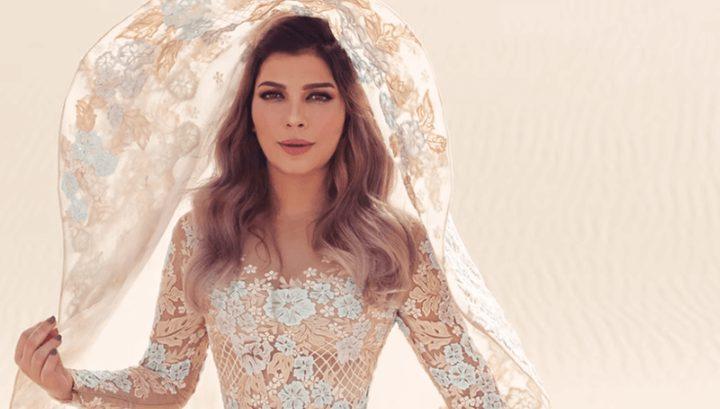 فستان أصالة المزيّن بالريش يحيّر الجمهور