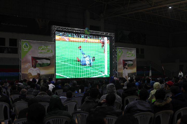 المشجعون الفلسطينيون يشاهدون كأس  الامم الآسيوية 2019 في الفترة ما بين فلسطين وسوريا ، في مدينة غزة في 6 يناير 2019.