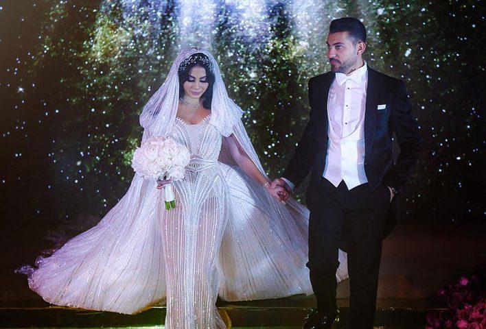 بالصور:ملكة جمال تبهر العالم بزفافها الفخم وفستانها المميز