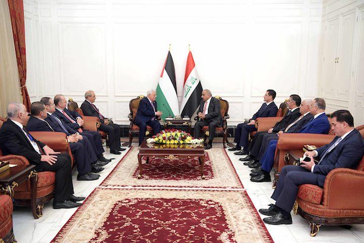 الرئيس الفلسطيني محمود عباس يجتمع مع رئيس الوزراء العراقي عادل عبد المهدي في بغداد في 03 مارس 2019.