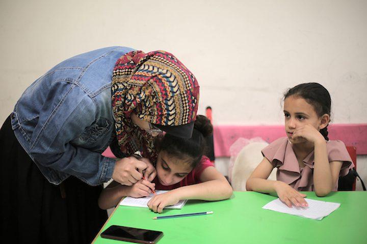 أطفال من ذوي الاحتياجات الخاصة، يحضرون معسكرًا صيفيًا ينظمه منتدى الشباب في مدينة غزة في 16 يونيو 2019. يجمع المخيم الأطفال ذوي الإعاقة وغيرهم من الأطفال ويديره مجموعة من المتطوعين.
