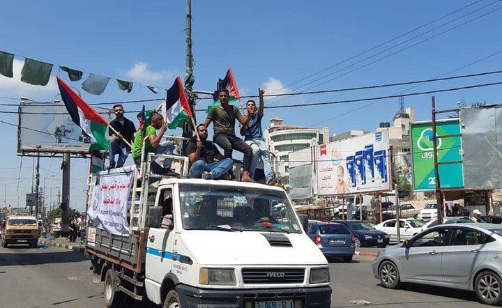مسيرة شاحنات في غزة رفضا للحصار