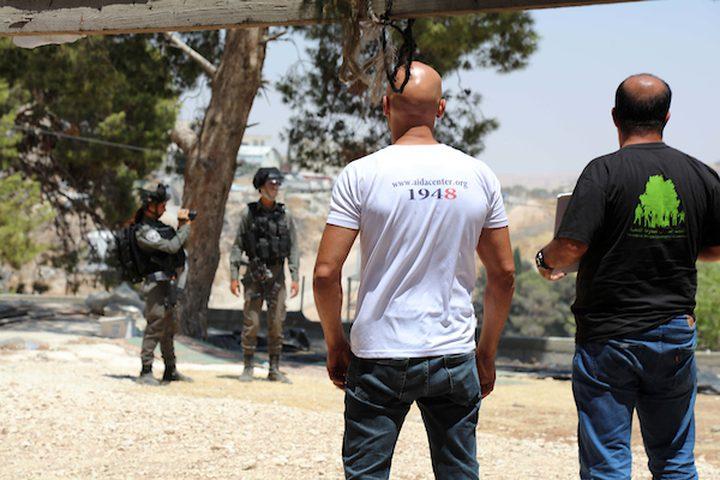 مواطنون يتظاهرون ضد عمليات الهدم الإسرائيلية للمنازل الفلسطينية في قرية صور باهر ، التي تقع على جانبي الجدار الفاصل الإسرائيلي في القدس الشرقية ، 02 آب / أغسطس 2019.