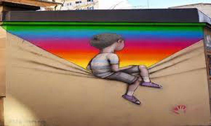 الفنان راني الشرباني من مدينة الخليل يبدع في الرسم على الجداريات
