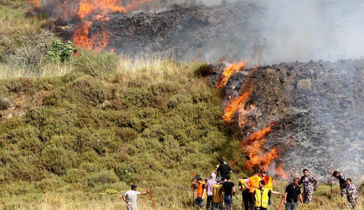 مستوطنون يحرقون مساحات شاسعة من أراضي قرية برقة
