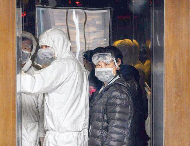 سيدة صينية تعيد نشر وباء كورونا بين جيرانها دون علمها