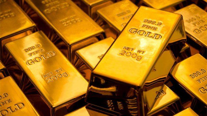 الذهب ينخفض عن ذروة أسبوع في ظل ضغوط ارتفاع الدولار