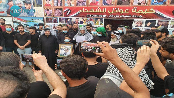 عوائل ضحايا الناصرية تحذر الحكومة من فض اعتصامها