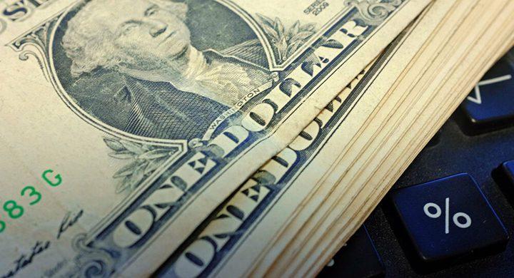 بدء سريان سعر صرف الدينار الليبي أمام الدولار الأمريكي