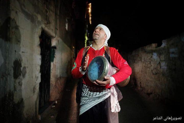 المسحراتي يجوب أزقة خانيونس جنوب قطاع غزة- تصوير  هاني الشاعر