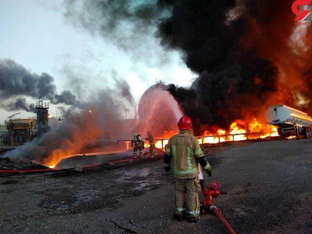 التلفزيون الإيراني: النيران تشتعل في 18 خزانا للنفط