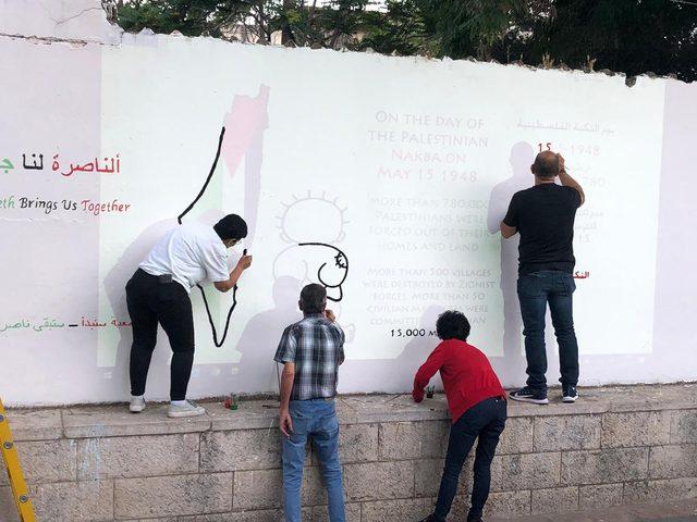 إعادة رسم جدارية فلسطين في الناصرة